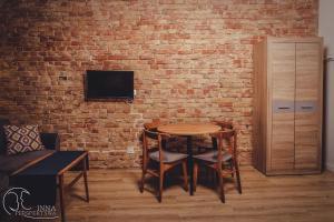 Telewizja i/lub zestaw kina domowego w obiekcie Apartamenty 21