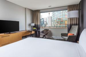A television and/or entertainment center at Novotel Sydney Darling Harbour