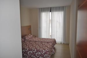 Een bed of bedden in een kamer bij Apartaments Trimar