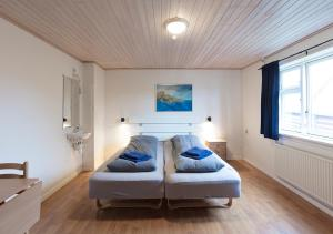 A bed or beds in a room at 62N Guesthouse - City Center