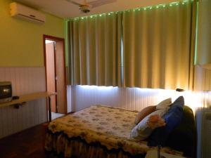 Cama ou camas em um quarto em Hotel Ivo De Conto
