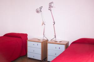 Un ou plusieurs lits dans un hébergement de l'établissement Orsa Maggiore Hostel seulement pour Femmes