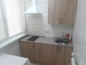 Кухня или мини-кухня в Мотель Евразия-Аксай