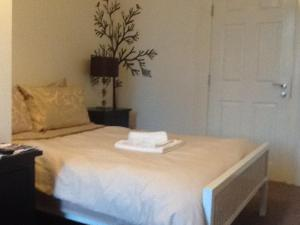 A bed or beds in a room at Regent Serviced Suites