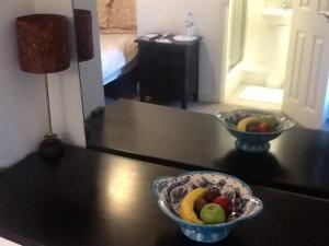 A kitchen or kitchenette at Regent Serviced Suites