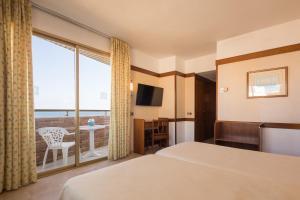 Een bed of bedden in een kamer bij htop Royal Sun