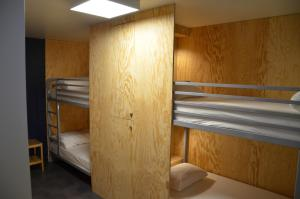 A bunk bed or bunk beds in a room at Eklo Hotels Lille