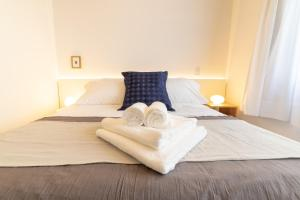 A bed or beds in a room at Babel Soho