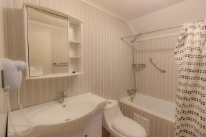 Um banheiro em Cabañas Última Esperanza