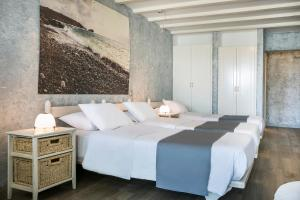 A bed or beds in a room at Ilio Maris