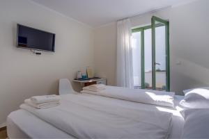 A bed or beds in a room at Hotel Vila Conte