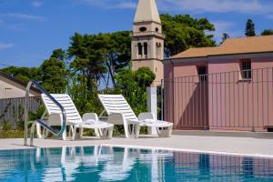 The swimming pool at or near Hotel Vila Conte