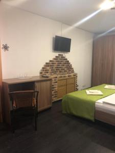 "A bed or beds in a room at Отель ""Старая Можайка"""