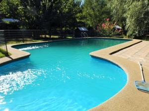The swimming pool at or near Cabañas Aguas Claras