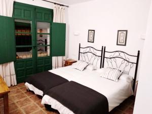 Cama o camas de una habitación en Palacio Buenavista Hospederia