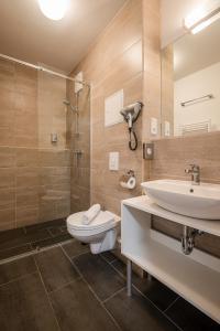 A bathroom at Hotel City Green Berlin