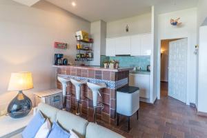 Кухня или мини-кухня в Apartment Diana