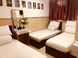 A bed or beds in a room at Tian Jin Hostel