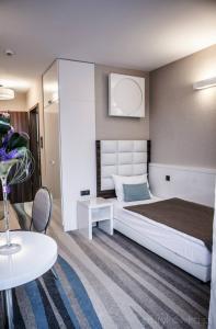 A bathroom at Hotel Pogoria Residence