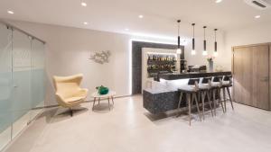 Ο χώρος του lounge ή του μπαρ στο Castello Hotel
