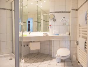Ein Badezimmer in der Unterkunft BE BIO Hotel be active