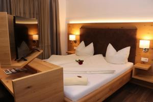 Ein Bett oder Betten in einem Zimmer der Unterkunft Gasthaus Kerber