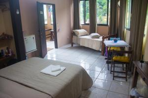 A bed or beds in a room at Ponta Da Barca