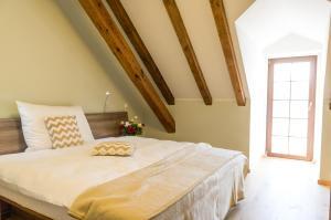 A bed or beds in a room at Olivův Pivovar