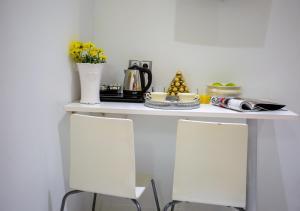 A kitchen or kitchenette at Bloom Inn Madrid