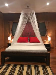 Ein Bett oder Betten in einem Zimmer der Unterkunft Thai Terrace Bungalow