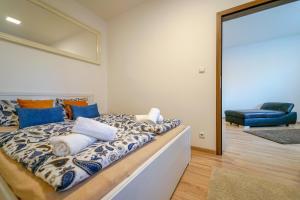 A bed or beds in a room at Vesna Convenient Apartment
