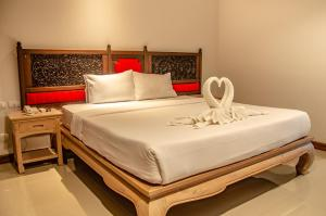 A bed or beds in a room at A BOUTIQUE HOTEL