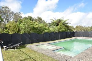 The swimming pool at or close to Waitomo Boutique Lodge