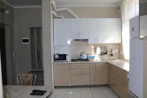 Кухня или мини-кухня в Квартира для отдыха