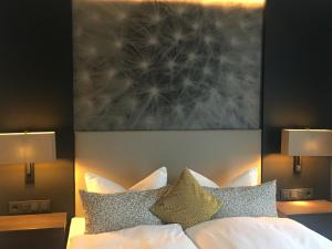 Ein Bett oder Betten in einem Zimmer der Unterkunft Kranz Parkhotel