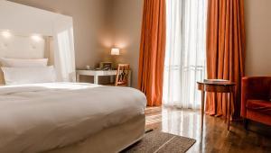 Ein Bett oder Betten in einem Zimmer der Unterkunft Hotel Gerbermühle