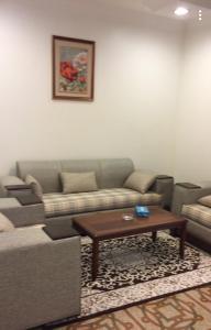 Uma área de estar em Almamcha Hotel
