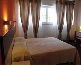 A bed or beds in a room at Hotel Milano