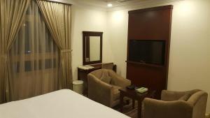 Uma área de estar em Elaf Suites Al-Andalus
