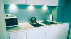 Kuchnia lub aneks kuchenny w obiekcie Apartamenty Topaz