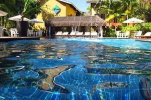 A piscina localizada em Ilha Flat Hotel-Apartamento Schiavetti-Ilhabela ou nos arredores