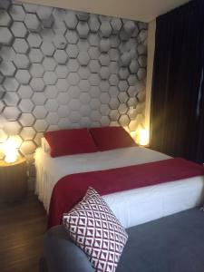 A bed or beds in a room at Studios Centro SP 16