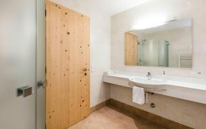 Ванная комната в Hotel Weisses Rössl 3Sup