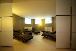 Ein Sitzbereich in der Unterkunft Villa Toscana