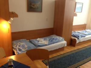 A bed or beds in a room at Hotel Prim