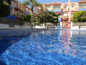 The swimming pool at or near Apartamentos Marina Internacional