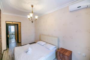 Cama ou camas em um quarto em Vip Central in Nizami Street