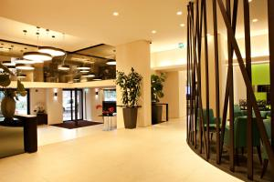 The lobby or reception area at Hotel Manin