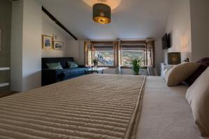 Cama o camas de una habitación en La Maroma Rooms & Views