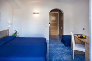 A bed or beds in a room at Grifo Hotel Charme & SPA